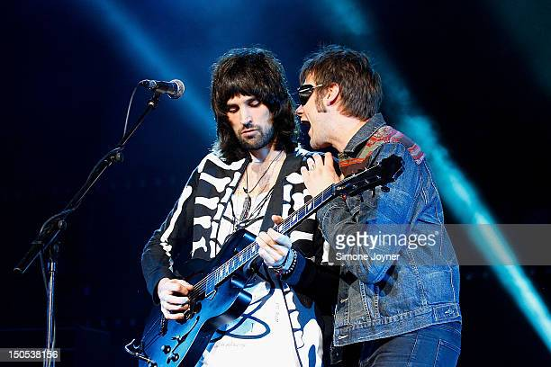 Sergio Pizzorno and Tom Meighan of Kasabian perform live on stage at Brixton Academy on August 20 2012 in London United Kingdom