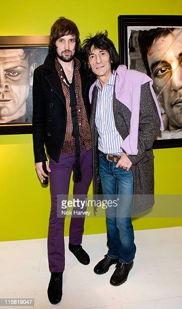 Sergio Pizzorno of Kasabian and Ronnie Wood attend the Paul Karslake private view at Scream on February 21 2008 in London England