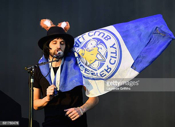 Sergio Pizzorno of Kasabian performs during the Leicester City Barclays Premier League winners bus parade on May 16 2016 in Leicester England