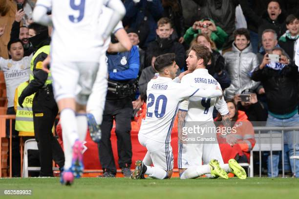 Sergio Ramos #4 of Real Madrid celebrates with Asensio #20 of Real Madrid after scoring his team's second goal during the La Liga match between Real...