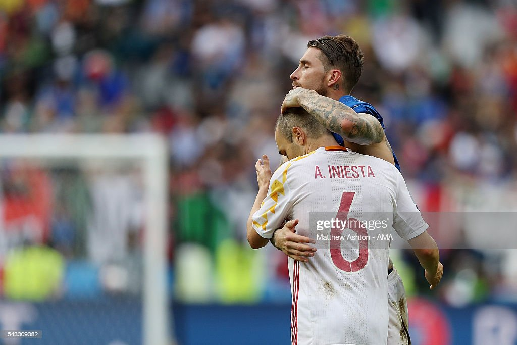 Sergio Ramos and <a gi-track='captionPersonalityLinkClicked' href=/galleries/search?phrase=Andres+Iniesta&family=editorial&specificpeople=465707 ng-click='$event.stopPropagation()'>Andres Iniesta</a> of Spain show their dejection at the end of the UEFA Euro 2016 Round of 16 match between Italy and Spain at Stade de France on June 27, 2016 in Paris, France.
