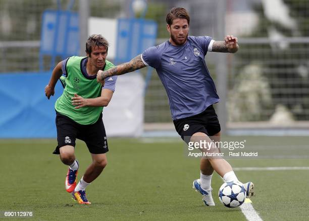 Sergio Ramos and Fabio Coentrao of Real Madrid in action during a training session at Valdebebas training ground on May 30 2017 in Madrid Spain