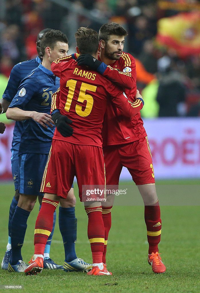 Sergio Ramos and <a gi-track='captionPersonalityLinkClicked' href=/galleries/search?phrase=Gerard+Pique&family=editorial&specificpeople=227191 ng-click='$event.stopPropagation()'>Gerard Pique</a> of Spain congratulate each other after the FIFA World Cup 2014 qualifier match between France and Spain at the Stade de France on March 26, 2013 in Saint-Denis near Paris, France.