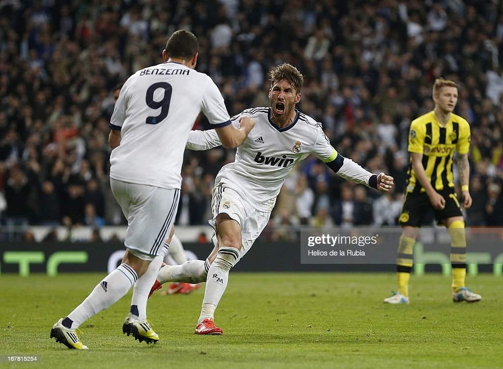 Sergio Ramos (C) and <a gi-track='captionPersonalityLinkClicked' href=/galleries/search?phrase=Karim+Benzema&family=editorial&specificpeople=796089 ng-click='$event.stopPropagation()'>Karim Benzema</a> (L) of Real Madrid celebrate after scoring during the UEFA Champions League Semi Final second leg match between Real Madrid and Borussia Dortmund at Estadio Santiago Bernabeu on April 30, 2013 in Madrid, Spain.