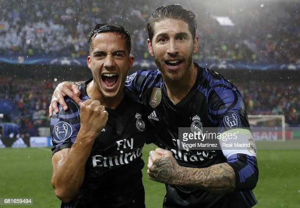 Sergio Ramos and Lucas Vazquez of Real Madrid celebrate after the UEFA Champions League Semi Final second leg match between Club Atletico de Madrid...
