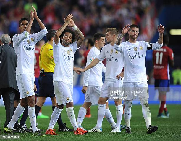 Sergio Ramos and Marcelo of Real Madrid applaud Real fans after they drew 11 in the La Liga match between Club Atletico de Madrid and Real Madrid at...
