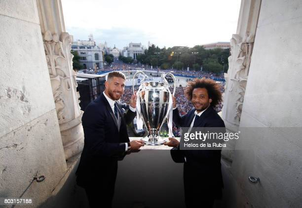 Sergio Ramos and Marcelo of Real Madrid celebrate their UEFA Champions League victory at Cibeles square on June 4 2017 in Madrid Spain