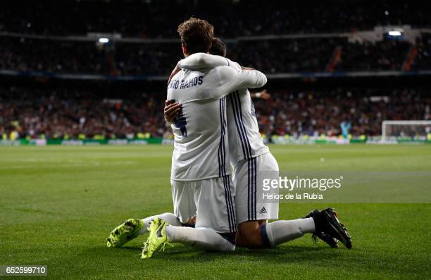 Sergio Ramos and Marco Asensio of Real Madrid celebrates after scoring during the La Liga match between Real Madrid and Real Betis Balompie at...
