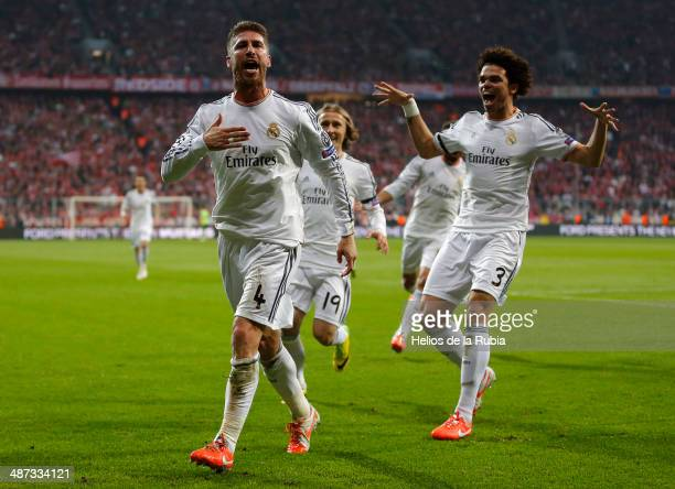 Sergio Ramos and Pepe of Real Madrid celebrate after scoring during the UEFA Champions League Semi Final second leg match between FC Bayern Muenchen...