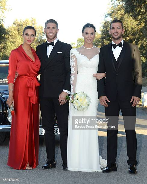 Sergio Ramos and Pilar Rubio attend the wedding of Real Madrid football player's brother Rene Ramos and ex Miss Spain Vania Millan on July 20 2014 in...