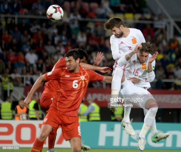 Sergio Ramos and Sergio Besquets of Spain in action during the FIFA 2018 World Cup Qualifiers Group G match between Macedonia and Spain at Philip II...