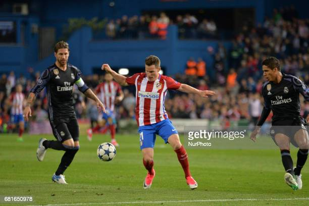 Sergio Ramos and Varane of Real Madrid and Gameiro of Atletico de Madrid in action during the match between Real Madrid CF vs Atletico de Madrid as...