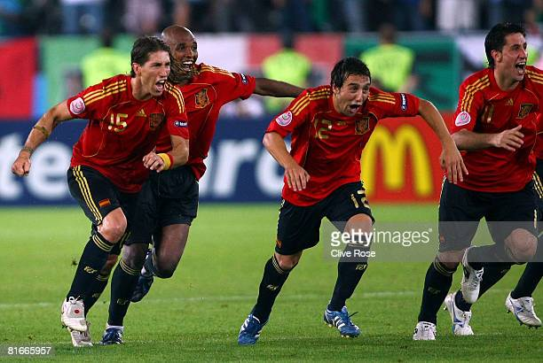 Sergio Ramos Marcos Senna and Santi Cazorla of Spain celebrate after Cesc Fabregas of Spain shoots and scores the winning penalty in the shoot out...