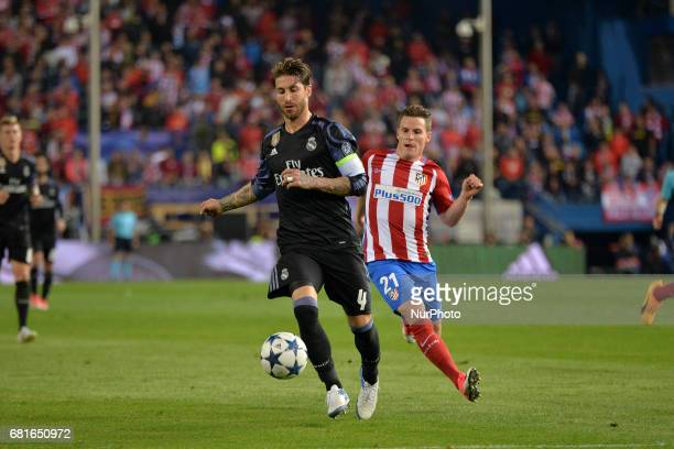 Sergio Ramos of Real Madrid and Gameiro of Atletico de Madrid in action during the match between Real Madrid CF vs Atletico de Madrid as part of EUFA...