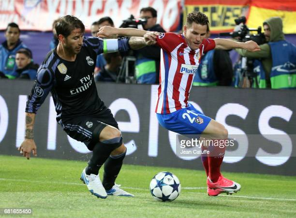 Sergio Ramos of Real Madrid and Kevin Gameiro of Atletico Madrid during the UEFA Champions League Semi Final second leg match between Club Atletico...