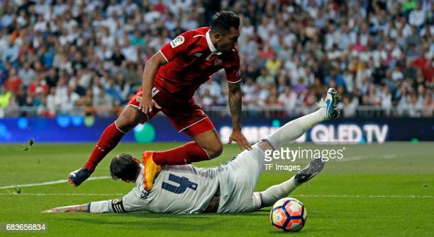 Sergio Ramos of Real Madrid and Kranevitter of Sevilla battle for the ball during the La Liga match between Real Madrid CF and Sevilla CF at Estadio...