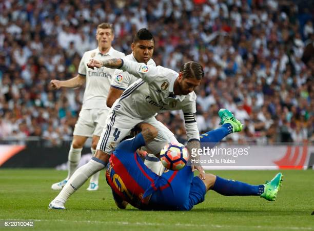 Sergio Ramos of Real Madrid and Luis Suarez of FC Barcelona compete for the ball during the La Liga match between Real Madrid CF and Barcelona at...