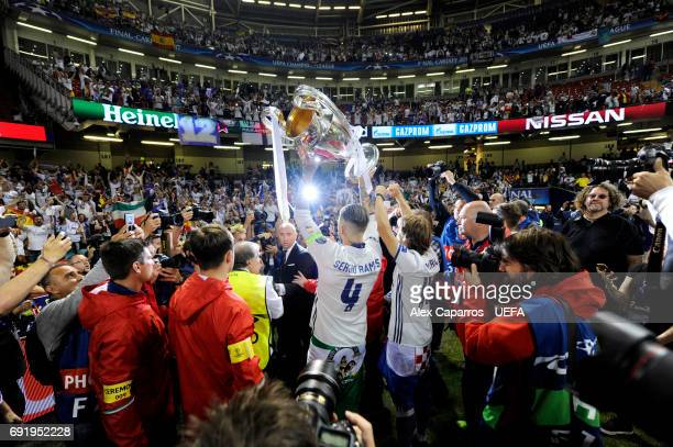 Sergio Ramos of Real Madrid and Luka Modric of Real Madrid celebrate with the trophy after the UEFA Champions League Final between Juventus and Real...