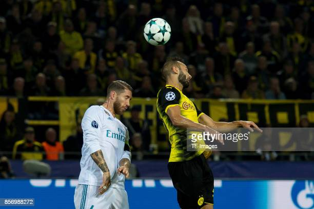 Sergio Ramos of Real Madrid and Oemer Toprak of Dortmund battle for the ball during the UEFA Champions League group H match between Borussia Dortmund...