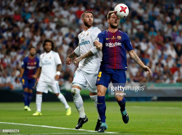 Sergio Ramos of Real Madrid and Rakitic of Barcelona battle for the ball during the Supercopa de Espana Supercopa Final 2nd Leg match between Real...