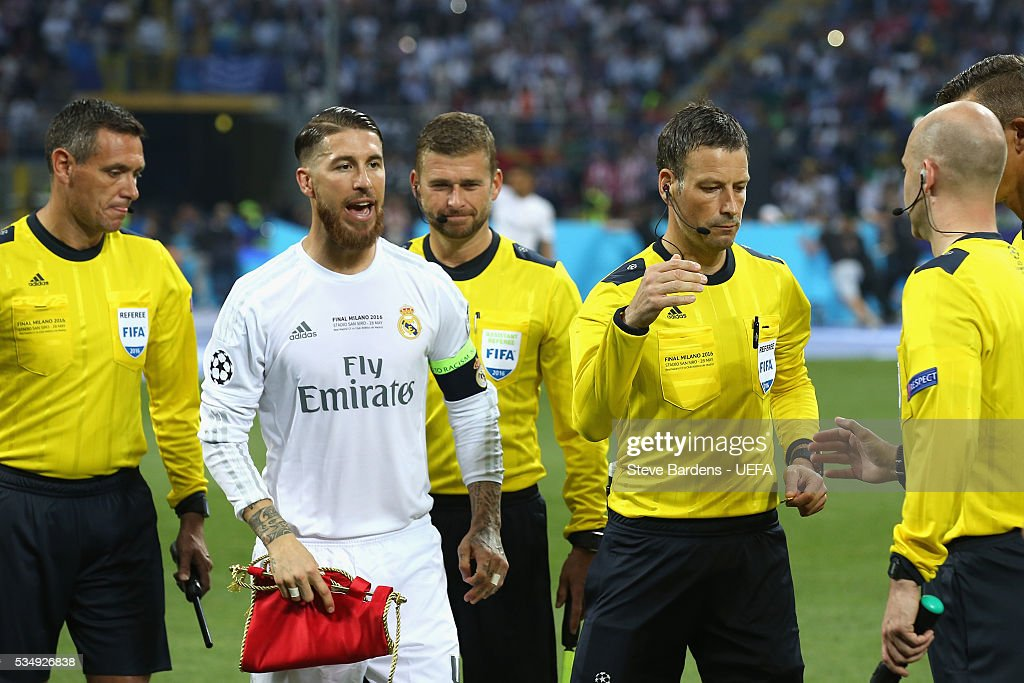 Sergio Ramos of Real Madrid and Referee <a gi-track='captionPersonalityLinkClicked' href=/galleries/search?phrase=Mark+Clattenburg&family=editorial&specificpeople=2108870 ng-click='$event.stopPropagation()'>Mark Clattenburg</a> are seen prior to the UEFA Champions League Final between Real Madrid and Club Atletico de Madrid at Stadio Giuseppe Meazza on May 28, 2016 in Milan, Italy.