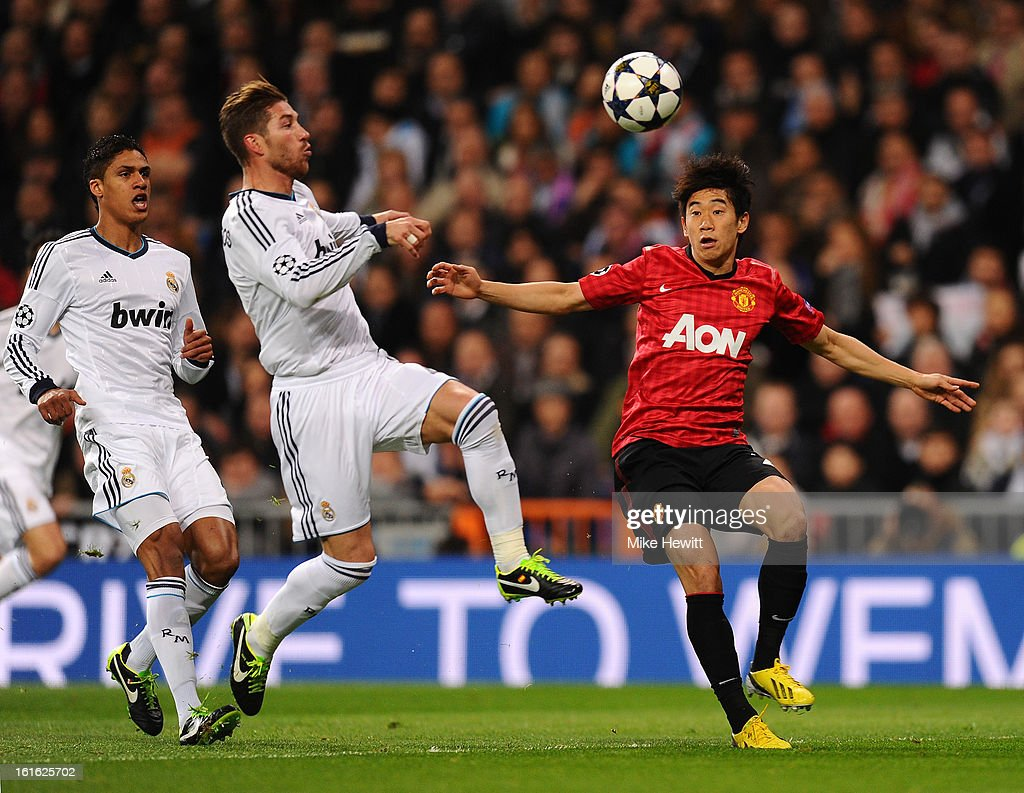Sergio Ramos of Real Madrid and Shinji Kagawa of Manchester United battle for the ball during the UEFA Champions League Round of 16 first leg match between Real Madrid and Manchester United at Estadio Santiago Bernabeu on February 13, 2013 in Madrid, Spain.