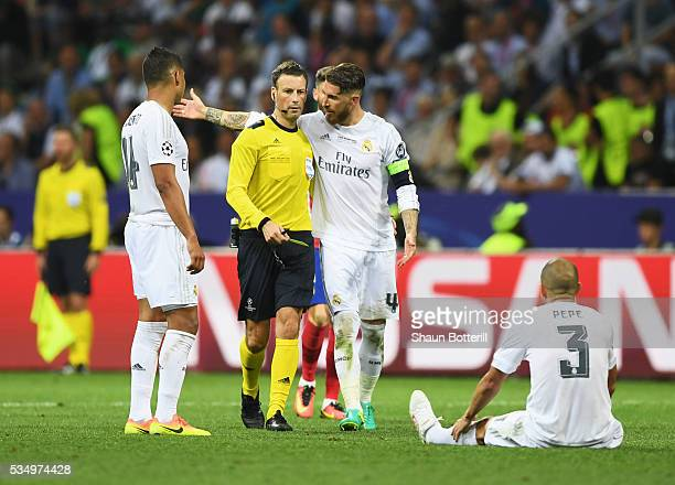 Sergio Ramos of Real Madrid argues with referee Mark Clattenburg during the UEFA Champions League Final match between Real Madrid and Club Atletico...