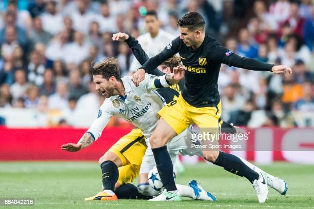 Sergio Ramos of Real Madrid battles for the ball with Lucas Hernandez of Atletico de Madrid during their 201617 UEFA Champions League Semifinals 1st...