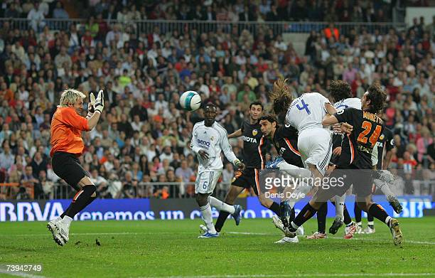Sergio Ramos of Real Madrid beats Valencia's goalkeeper Santiago Canizares to score Real's second goal during the Primera Liga match between Real...