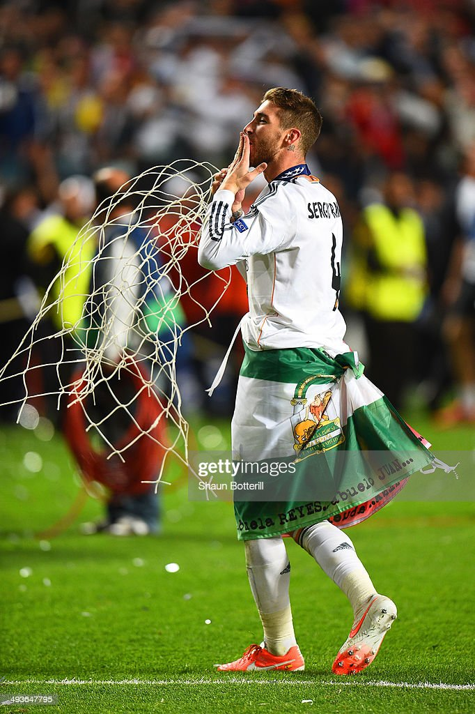 Sergio Ramos of Real Madrid blows kisses as he celebrates victory during the UEFA Champions League Final between Real Madrid and Atletico de Madrid at Estadio da Luz on May 24, 2014 in Lisbon, Portugal.