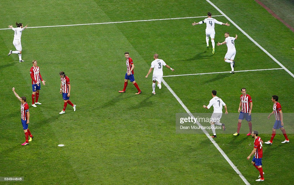 Sergio Ramos of Real Madrid celebrates after scoiring the opening goal during the UEFA Champions League Final match between Real Madrid and Club Atletico de Madrid at Stadio Giuseppe Meazza on May 28, 2016 in Milan, Italy.