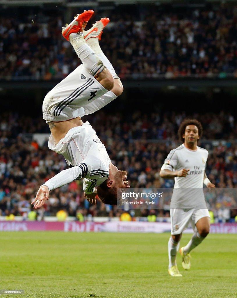Sergio Ramos (L) of Real Madrid celebrates after scoring during the La Liga match between Real Madrid and CA Osasuna at Estadio Santiago Bernabeu on April 26, 2014 in Madrid, Spain.