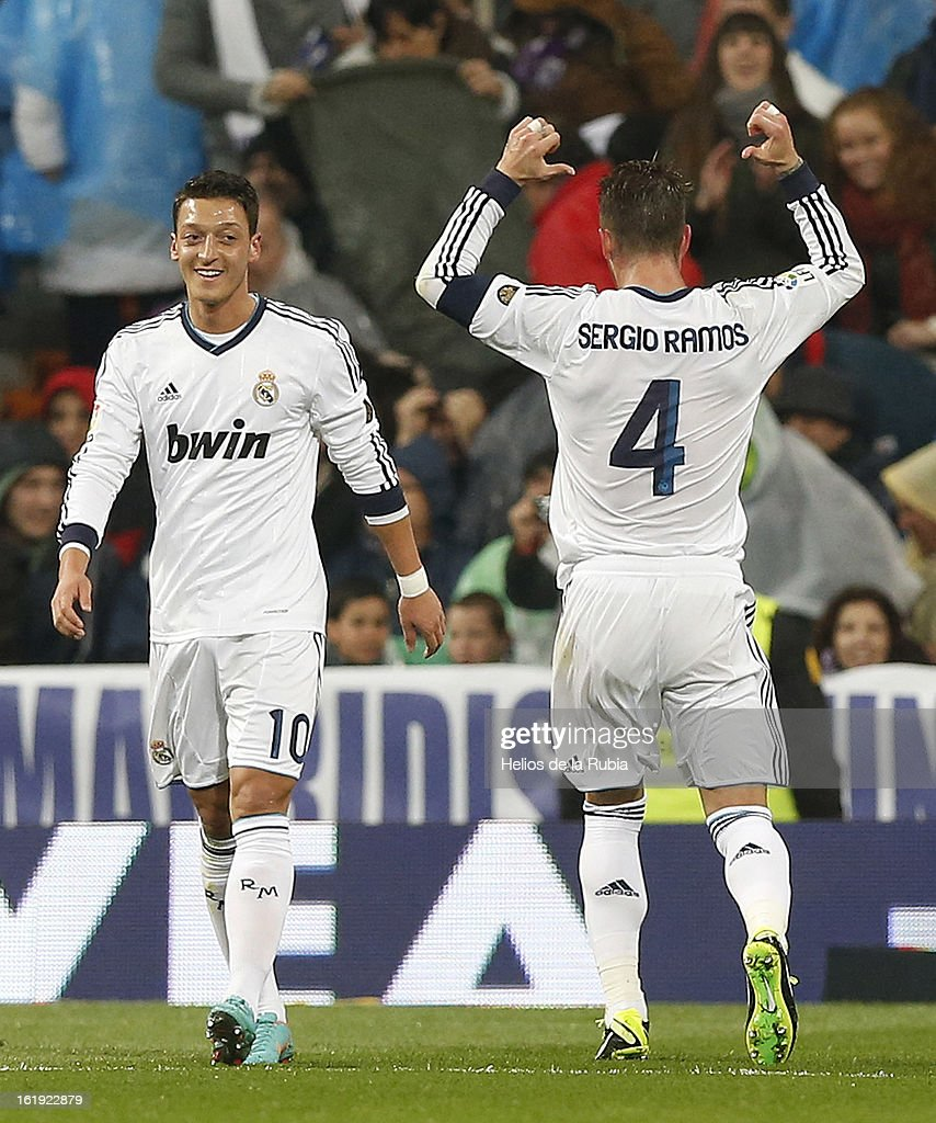 Sergio Ramos (R) of Real Madrid celebrates after scoring his team's second goal during the La Liga match between Real Madrid and Rayo Vallecano at Estadio Santiago Bernabeu on February 17, 2013 in Madrid, Spain.