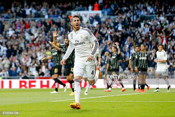Sergio Ramos of Real Madrid celebrates after scoring the opening goal during the La Liga match between Real Madrid CF and Malaga at Estadio Santiago...