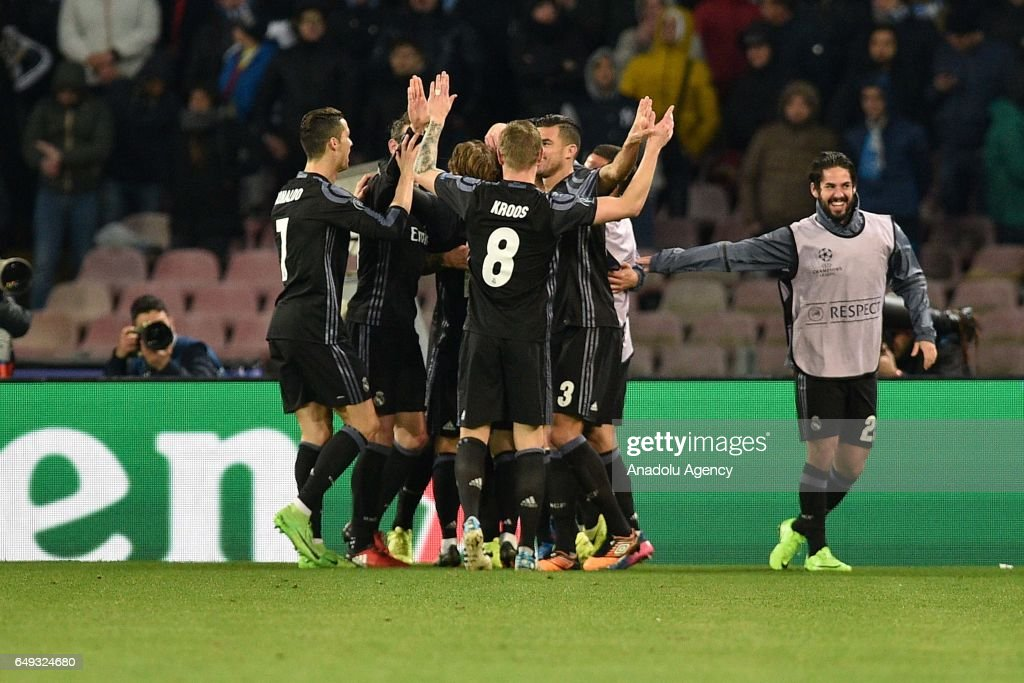 Sergio Ramos (4) of Real Madrid celebrates scoring a goal with his team mates during the UEFA Champions League Round of 16 second leg match between SSC Napoli and Real Madrid CF at Stadio San Paolo on March 7, 2017 in Naples, Italy.