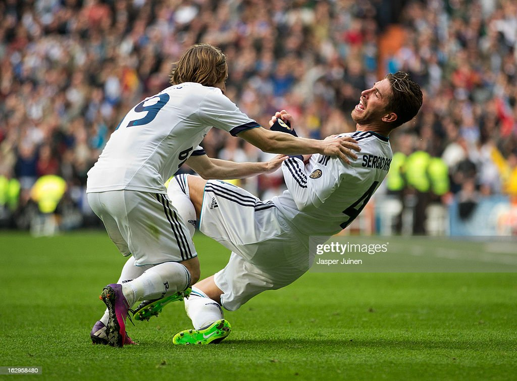 Sergio Ramos (R) of Real Madrid celebrates scoring his sides winning goal with his teammate <a gi-track='captionPersonalityLinkClicked' href=/galleries/search?phrase=Luka+Modric&family=editorial&specificpeople=560350 ng-click='$event.stopPropagation()'>Luka Modric</a> during the la Liga match between Real Madrid CF and FC Barcelona at Estadio Santiago Bernabeu on March 2, 2013 in Madrid, Spain.
