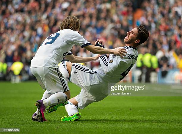 Sergio Ramos of Real Madrid celebrates scoring his sides winning goal with his teammate Luka Modric during the la Liga match between Real Madrid CF...