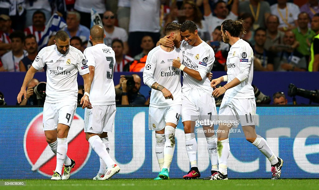 Sergio Ramos (C) of Real Madrid celebrates scoring his team's first goal with his team mates during the UEFA Champions League Final between Real Madrid and Club Atletico de Madrid at Stadio Giuseppe Meazza on May 28, 2016 in Milan, Italy.