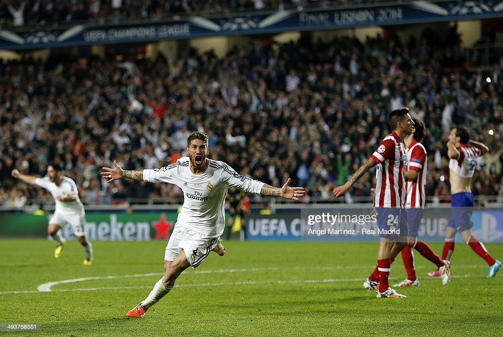 Sergio Ramos of Real Madrid celebrates scoring their first goal in stoppage time during the UEFA Champions League Final between Real Madrid and Atletico de Madrid at Estadio da Luz on May 24, 2014 in Lisbon, Portugal.