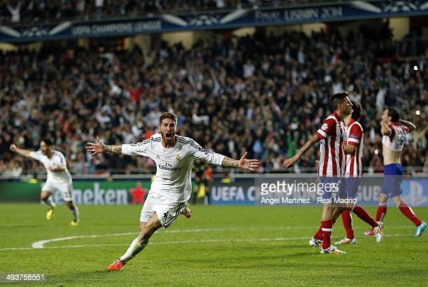 Sergio Ramos of Real Madrid celebrates scoring their first goal in stoppage time during the UEFA Champions League Final between Real Madrid and...