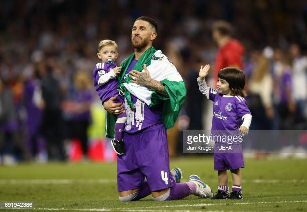 Sergio Ramos of Real Madrid celebrates victory with his children after the UEFA Champions League Final between Juventus and Real Madrid at National...