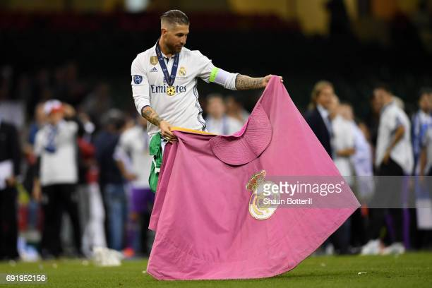 Sergio Ramos of Real Madrid celebrates with a Real Madrid flag after the UEFA Champions League Final between Juventus and Real Madrid at National...