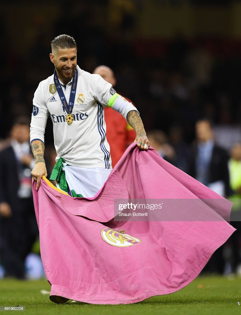 Sergio Ramos of Real Madrid celebrates with a Real Madrid flag after the UEFA Champions League Final between Juventus and Real Madrid at National Stadium of Wales on June 3, 2017 in Cardiff, Wales.