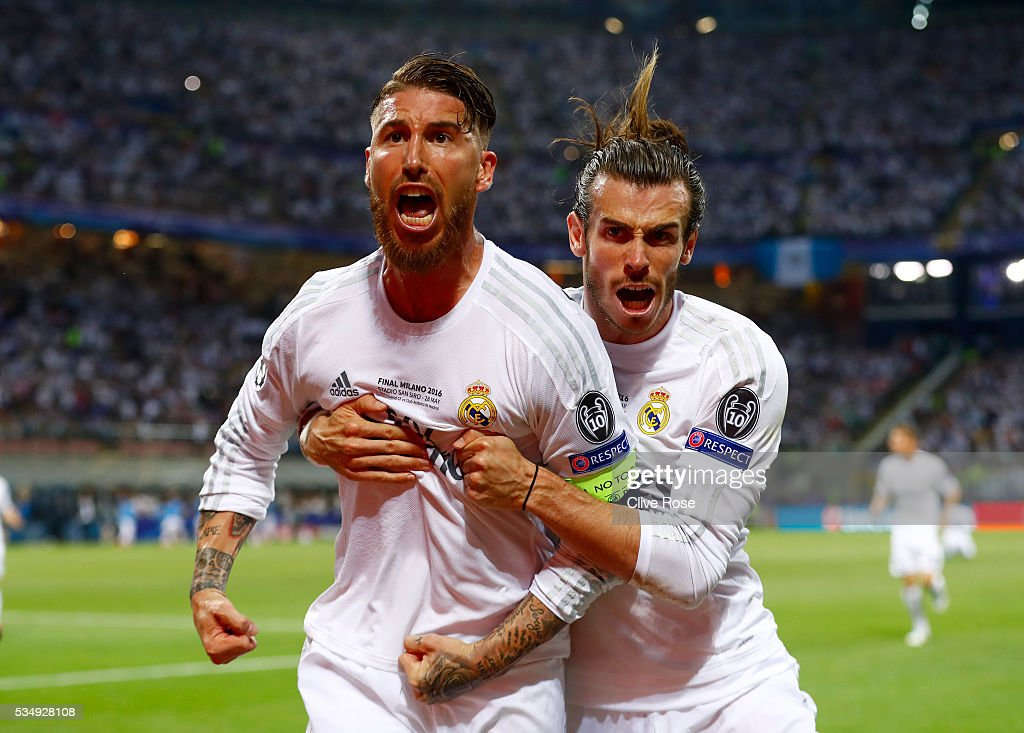 Sergio Ramos (l) of Real Madrid celebartes with <a gi-track='captionPersonalityLinkClicked' href=/galleries/search?phrase=Gareth+Bale&family=editorial&specificpeople=609290 ng-click='$event.stopPropagation()'>Gareth Bale</a> after scoring the opening goal during the UEFA Champions League Final match between Real Madrid and Club Atletico de Madrid at Stadio Giuseppe Meazza on May 28, 2016 in Milan, Italy.