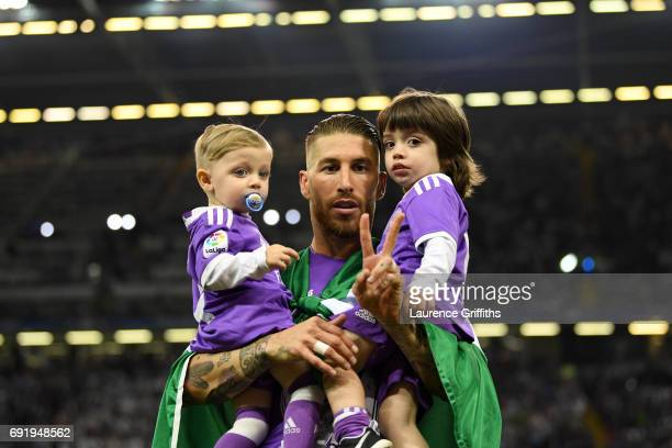 Sergio Ramos of Real Madrid celebrates with his children after the UEFA Champions League Final between Juventus and Real Madrid at National Stadium...