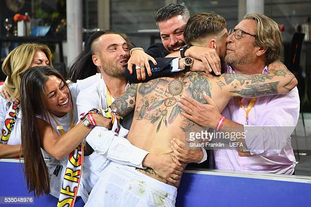 Sergio Ramos of Real Madrid celebrates with his family after the UEFA Champions League Final between Real Madrid and Club Atletico de Madrid at...