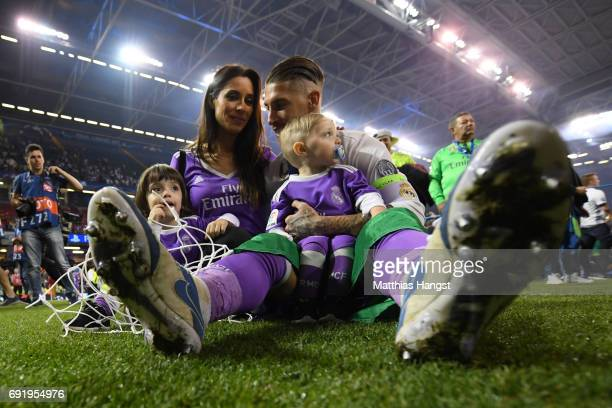 Sergio Ramos of Real Madrid celebrates with his family after the UEFA Champions League Final between Juventus and Real Madrid at National Stadium of...