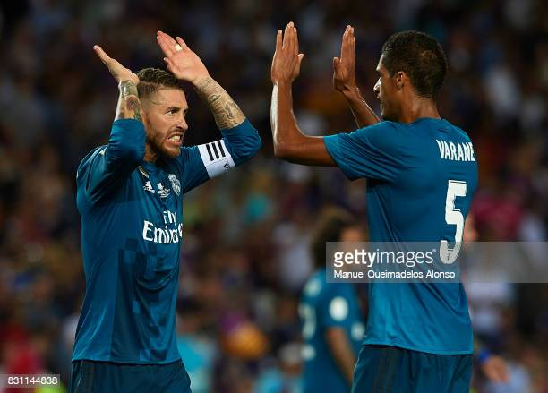 Sergio Ramos of Real Madrid celebrates with his teammate Raphael Varane after the end the Supercopa de Espana Supercopa Final 1st Leg match between...