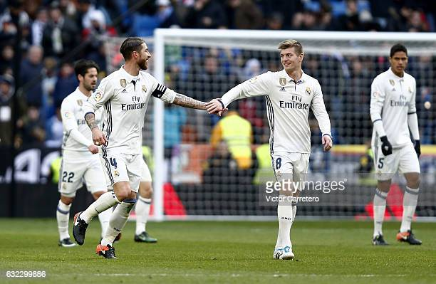 Sergio Ramos of Real Madrid celebrates with his teammate Toni Kroos after scoring the opening goal during the La Liga match between Real Madrid and...