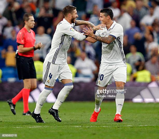 Sergio Ramos of Real Madrid celebrates with James Rodriguez after scoring during the La Liga match between Real Madrid CF and Villarreal CF at...